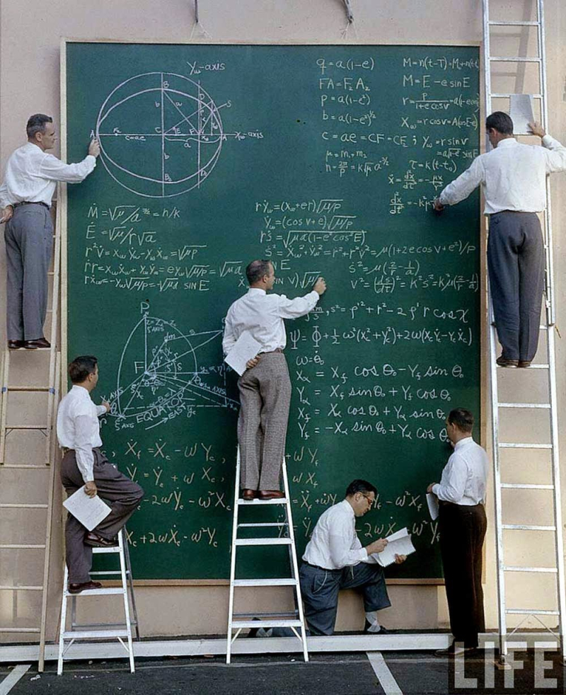 NASA scientists with their board of calculations, 1961.2