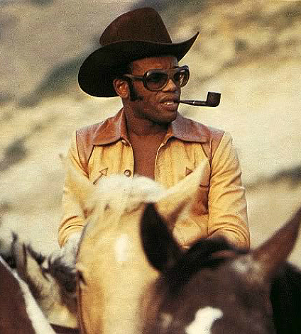 Bobby Womack con pipa y caballoOk