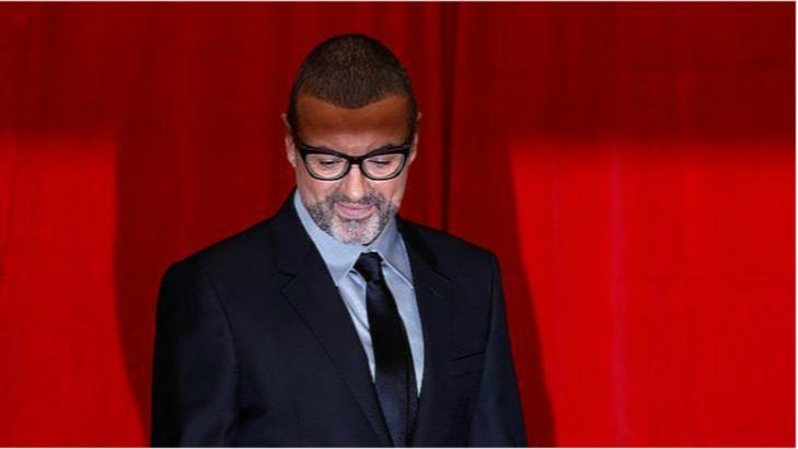 George Michael cabeza abajoOk